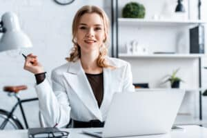 smiling business woman in formal wear in the office