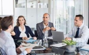 business meeting people around a glass table at a meeting