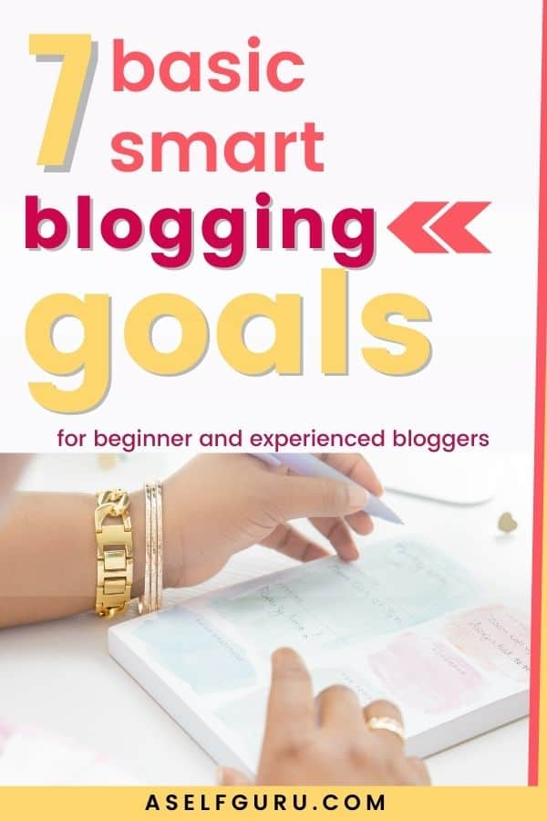 woman writing blogging goals on notepad