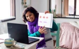 woman with purple scarf teaching online